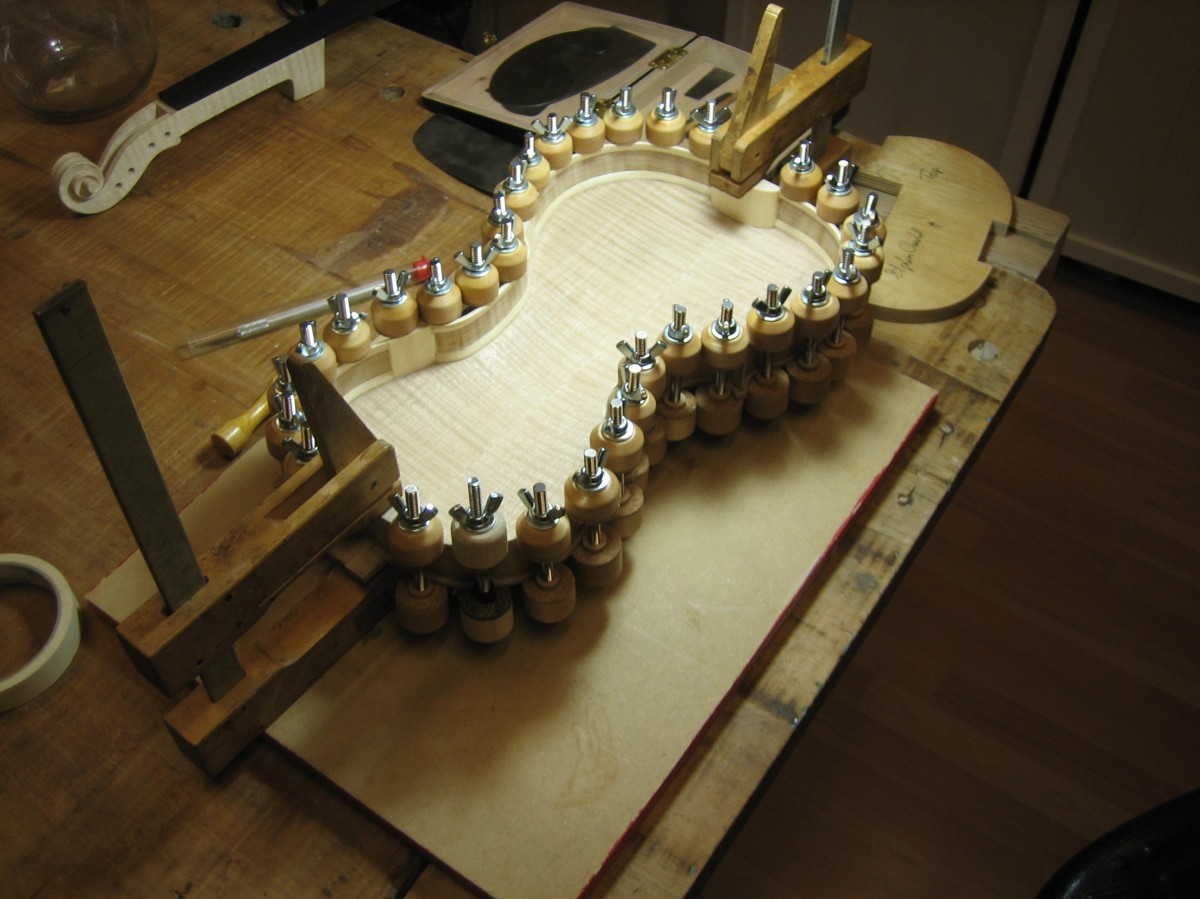 Gluing is done by removing a portion of the clamps at a time and moving around the ribline